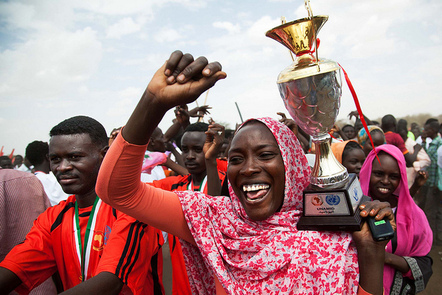 A women celebrates at the closing ceremony of a community football competition for internally displaced persons Nr Dafur.