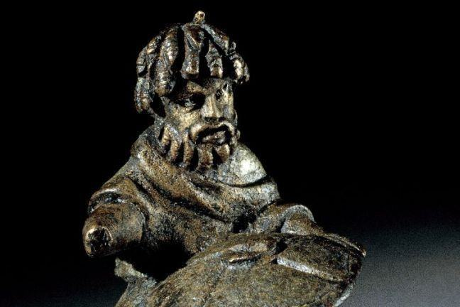 Copper-alloy figure of a horseman with  dreadlocks, a drooping moustache and a full beard