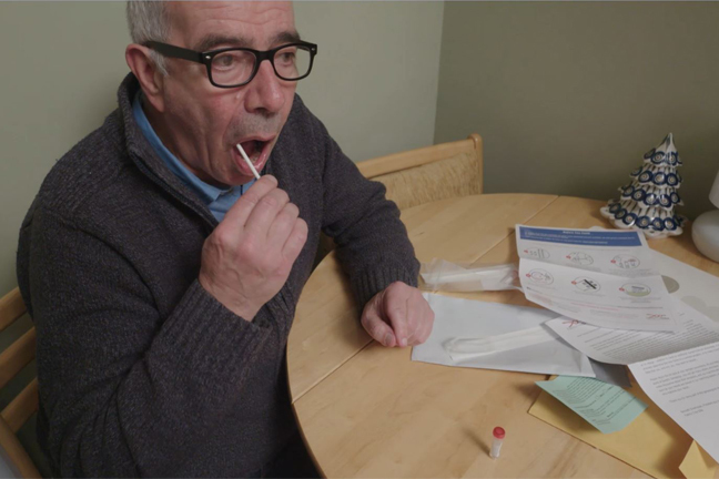Man taking mouth swap for a DNA test
