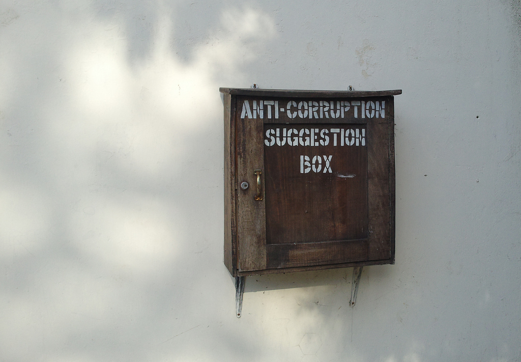 Box on wall with wording Anti corruption suggestion box