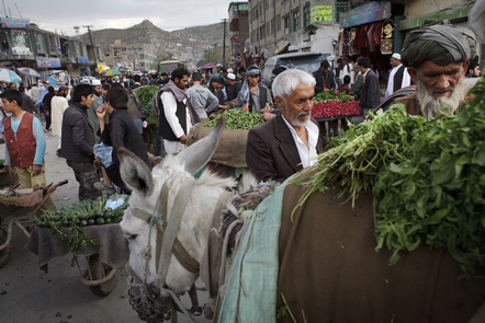 People shop in the market on May 8, 2012 in Kabul, Afghanistan.