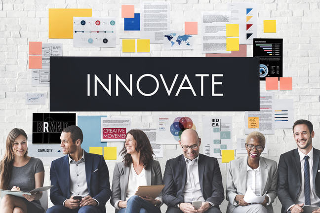 """A group of diverse people are lined up with the word """"innovation"""" captioned above."""