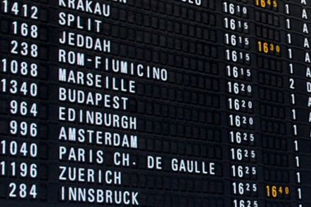 Close up of list of destinations on an airport departures board