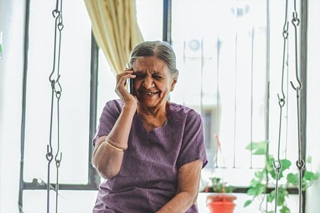 Lady on mobile phone smiling