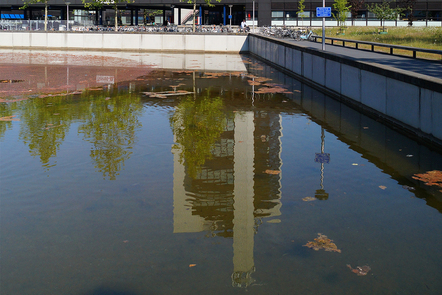 Horst Tower building reflected in pond at University of Twente