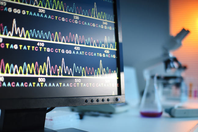 Image of genetic sequence on the screen within a lab