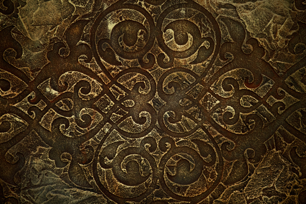Celtic design engraved onto a brass-like plate.