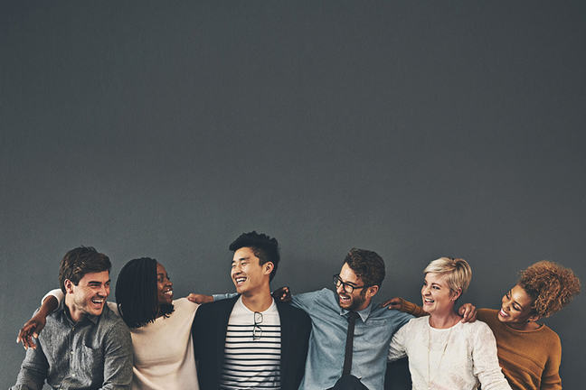 We make a great team Studio shot of a diverse group of creative employees embracing each other against a grey background