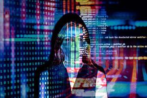 visual of computer code projected over woman's face