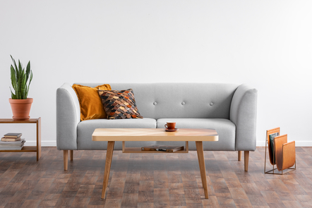 A couch placed in a living room of a house.