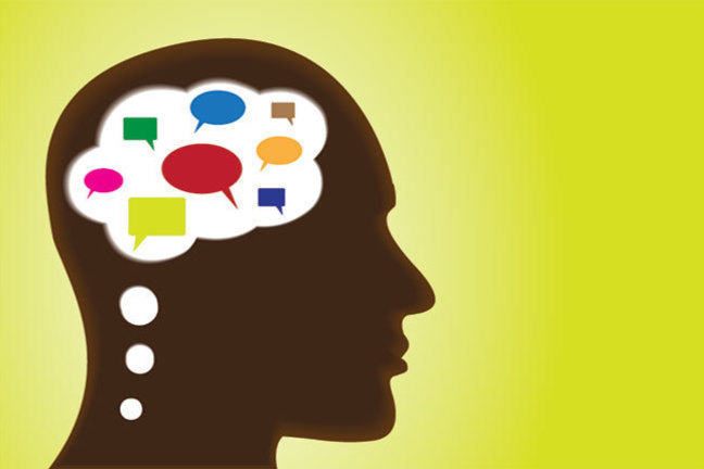 Head containing coloured speech bubbles on dark background