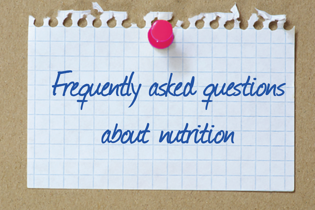A piece of paper pinned to a cork board with Nutrition and Fitness: Your Questions Answered written on it.