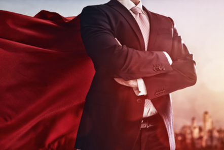 Business man wearing a cape, concept of success.