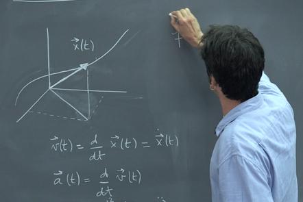 Luigi Del Debbio writing differential equations on a blackboard