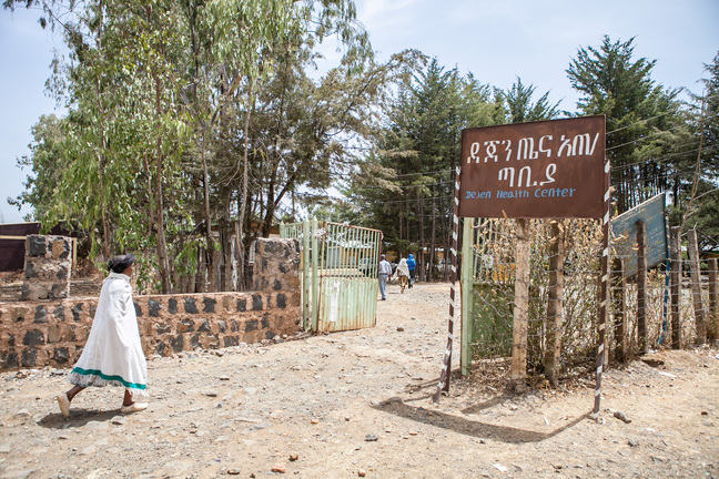 Image of a woman walking to a healthcare center in Ethiopia.