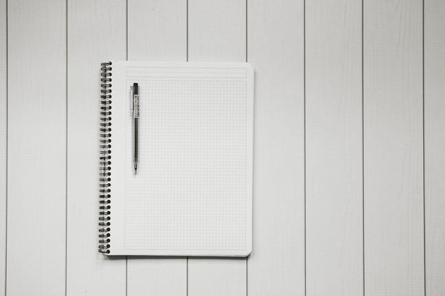 graphing notebook and pen