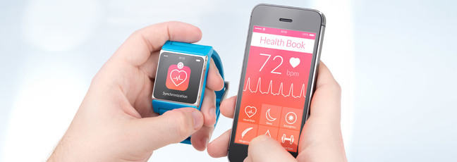 A smart watch and iPhone running health apps
