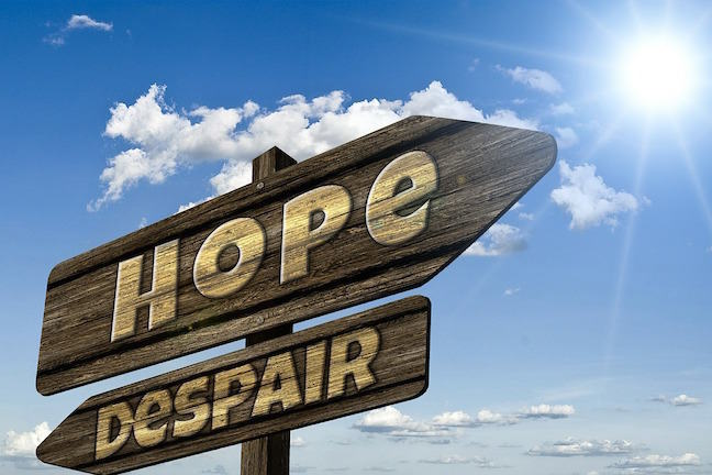 Signs directing towards hope and despair