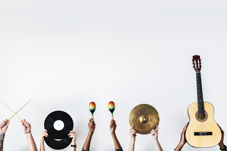 Hands holding musical instruments in the air