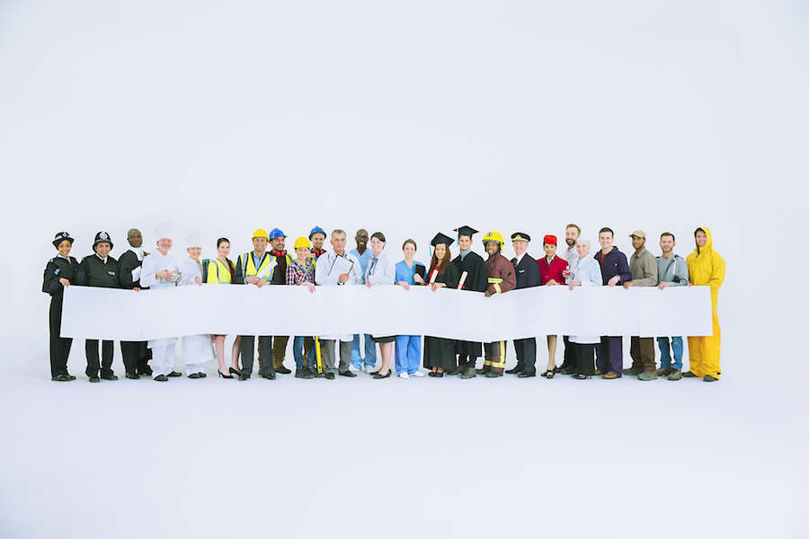 Series of people of different professions standing next to each other all holding paper