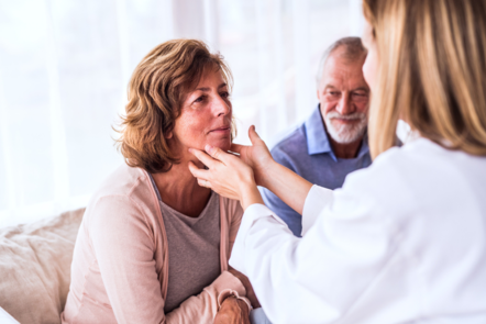Female GP checking a lady's throat ©Shutterstock