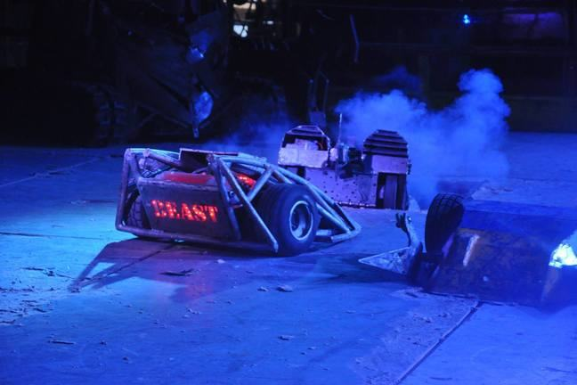 Several 100kg robots fighting in a robot wars arena