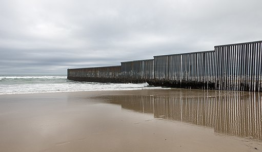 A large wall at the border between the US and Mexico