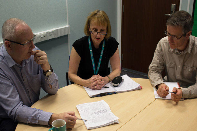 An image of a meeting to design the specification sheet for Fern's e-learning project.