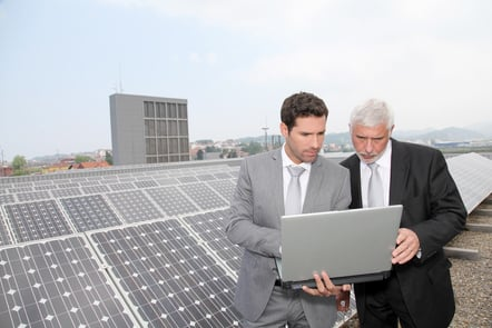 Business people standing by a PV plant