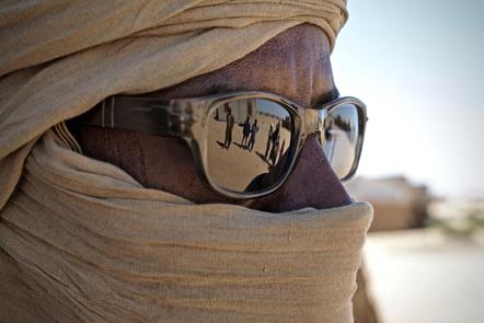 A veiled Nigerian refugee who fled Boko Haram violence.
