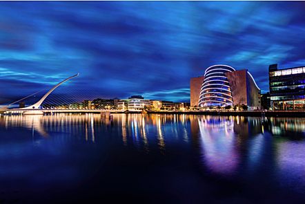 Dublin City Convention Centre and docklands at night.