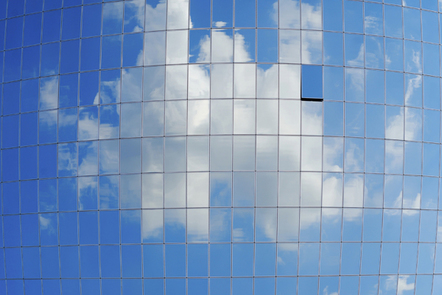 Reflection of a cloud on building window