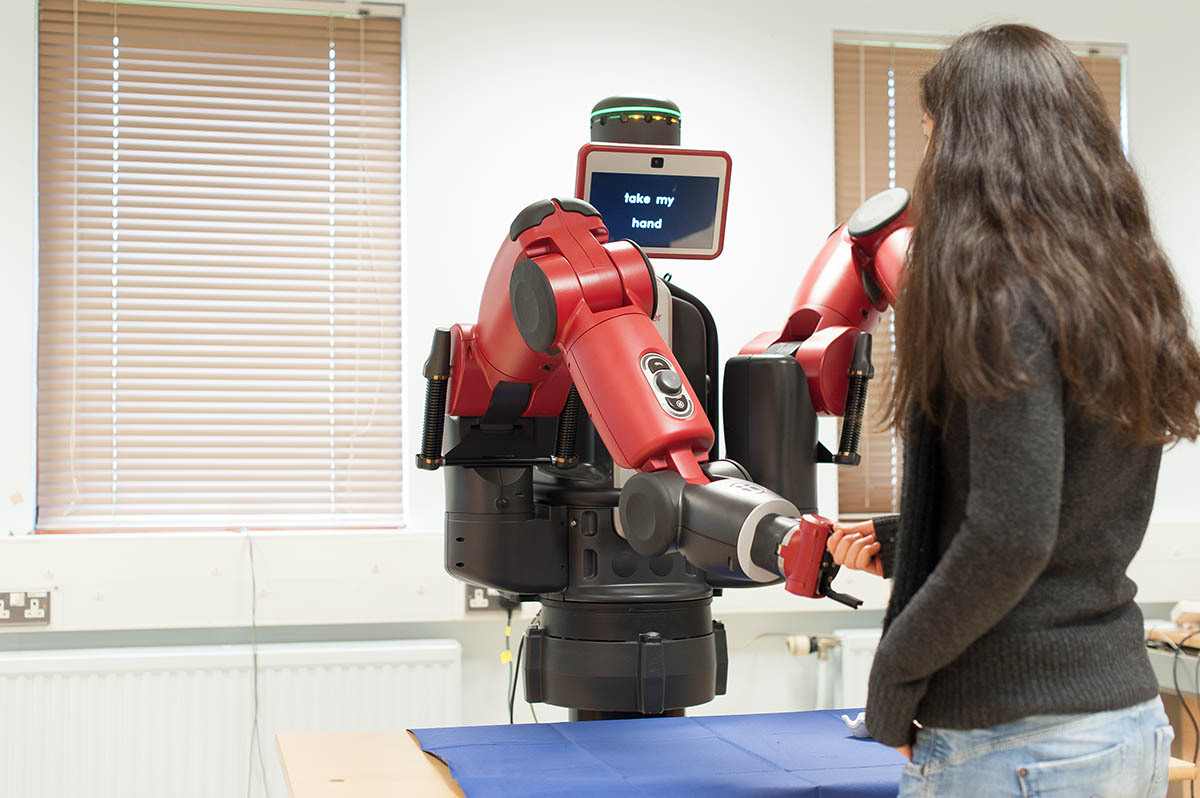 Baxter robot at the University of Reading 'shaking hands' with a student