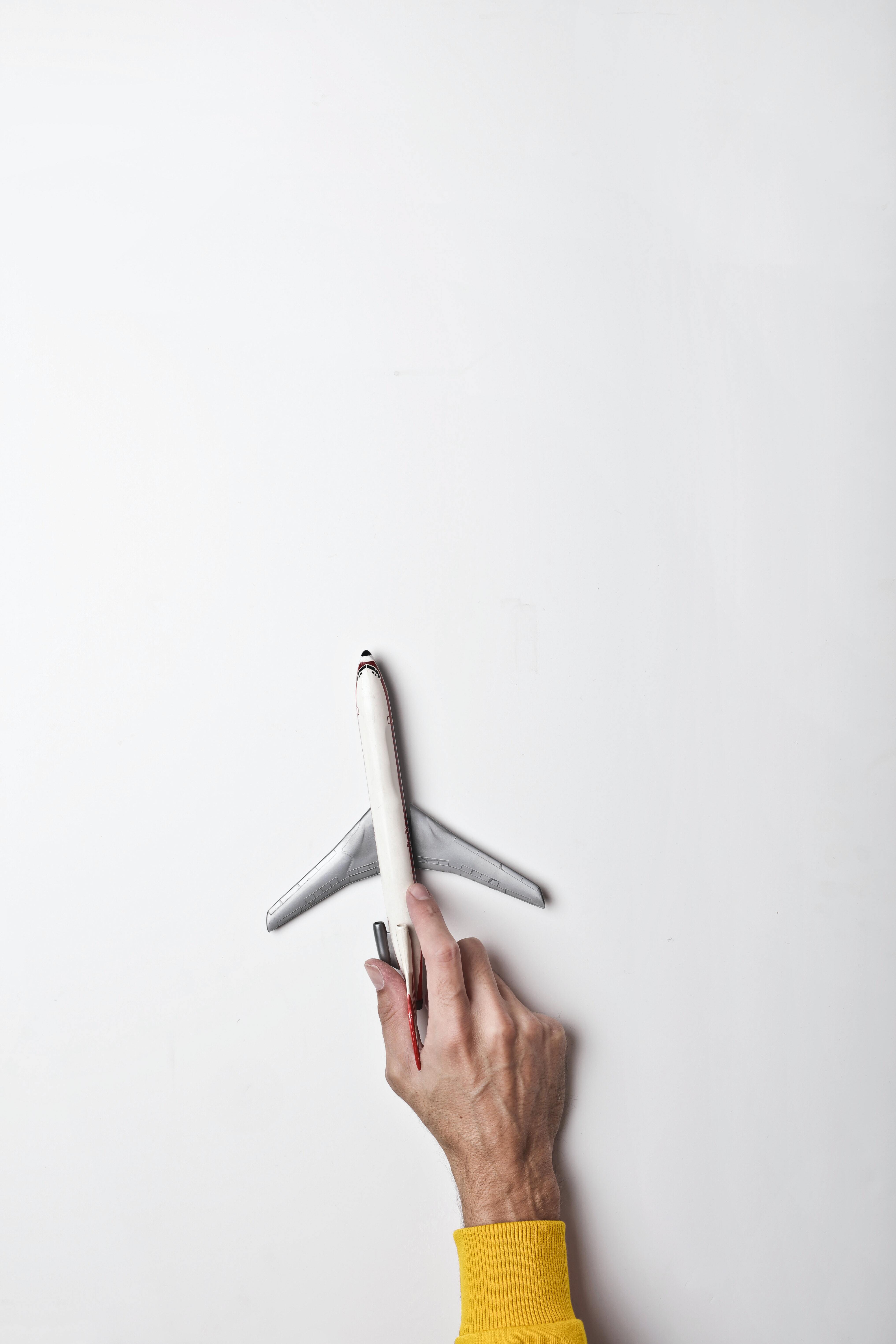 hand pushing a toy plane