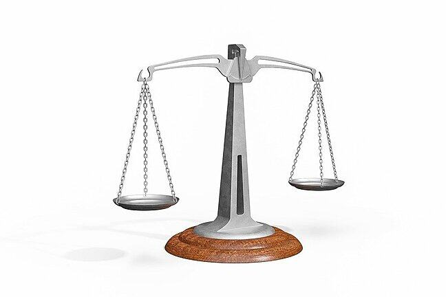 A pair of balance scales, like 'scales of justice'