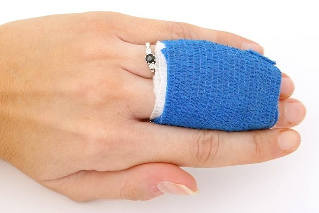 Fingers with a blue bandage round them