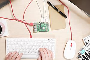 A Raspberry Pi connected to a Raspberry Pi keyboard and mouse