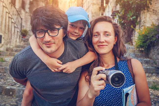 man, woman, and child tourists