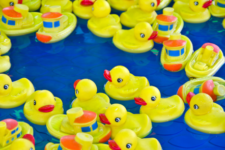 rubber ducks and boats in the water