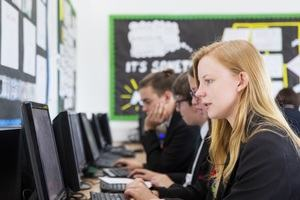 A set of GCSE students working at computers
