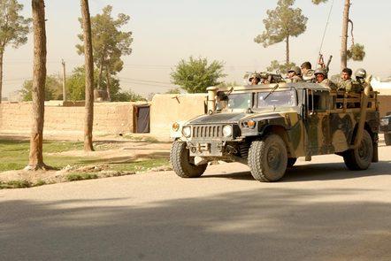 Afghan soldiers in a Humvee military vehicle.