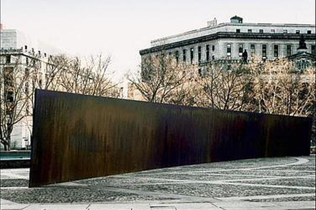 A photograph of Richard Serra's Tilted Arc in its original location
