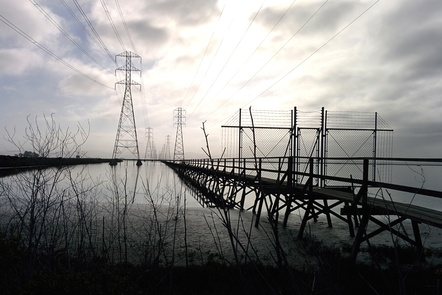 Pylons with electrical lines running over a river