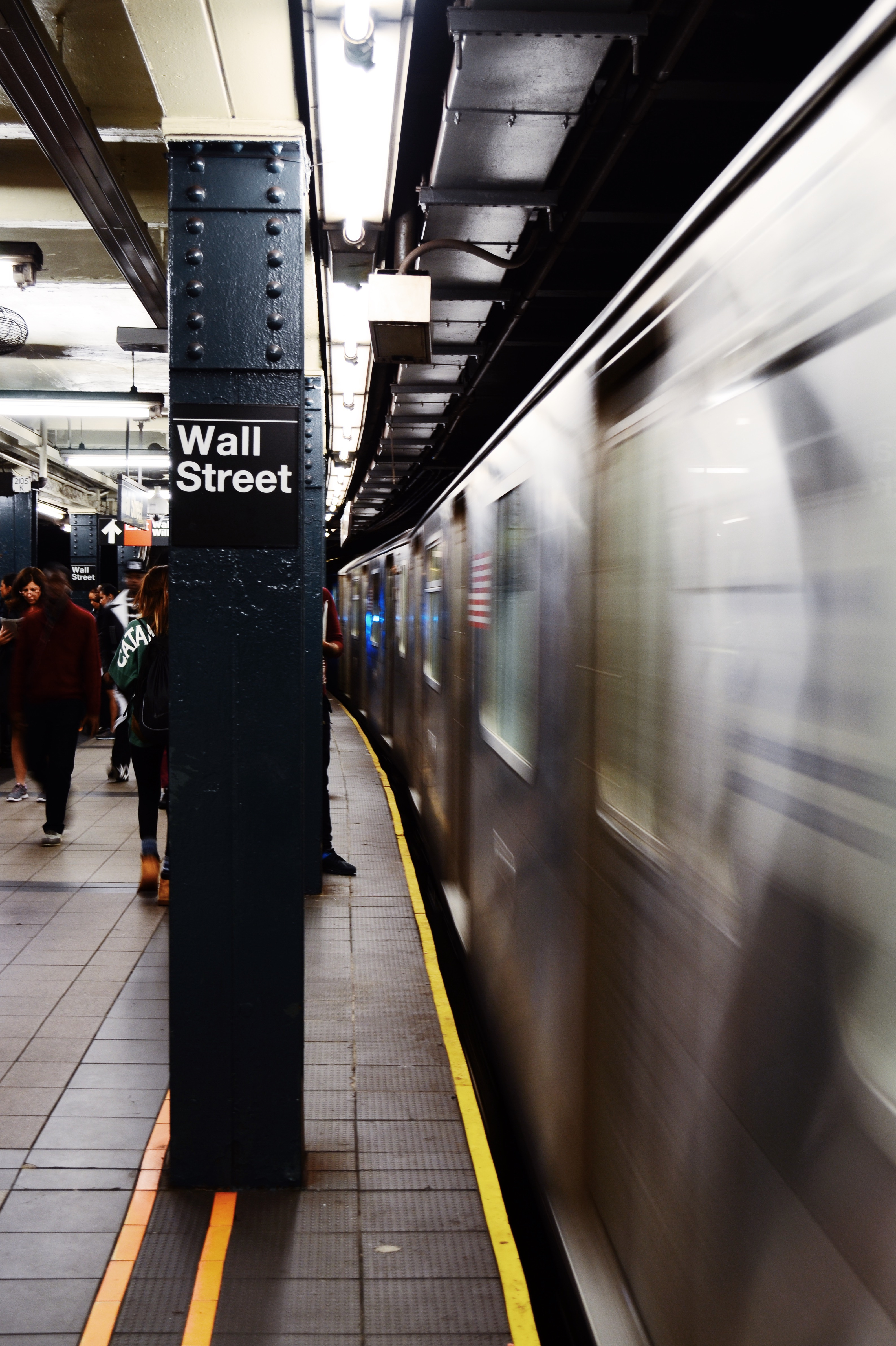 A train coming into Wall Street subway station