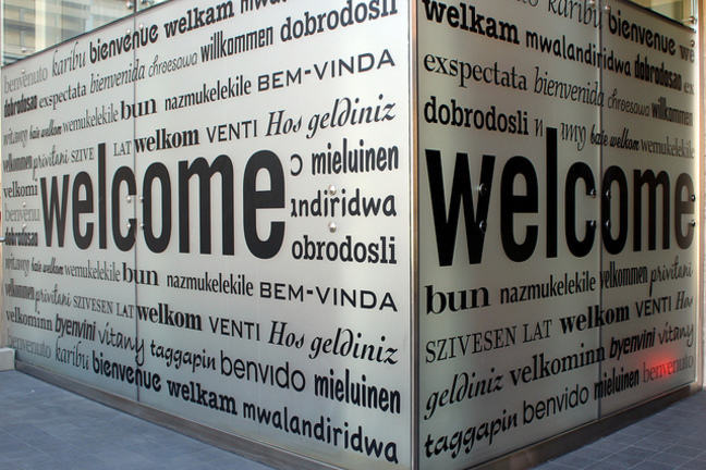 """Cube with """"Welcome"""" inscribed in multiple languages."""