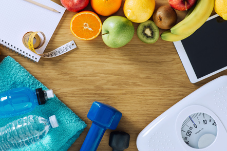 Photo of fruit, scales, tape measure, a water bottle and towel.