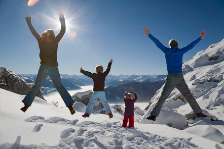 People jumping happy in snow