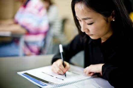 Young woman taking a test.