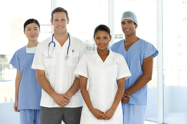 A team of doctors, two females and two males.