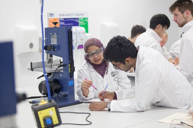 Engineering students conducting an experiment in the lab